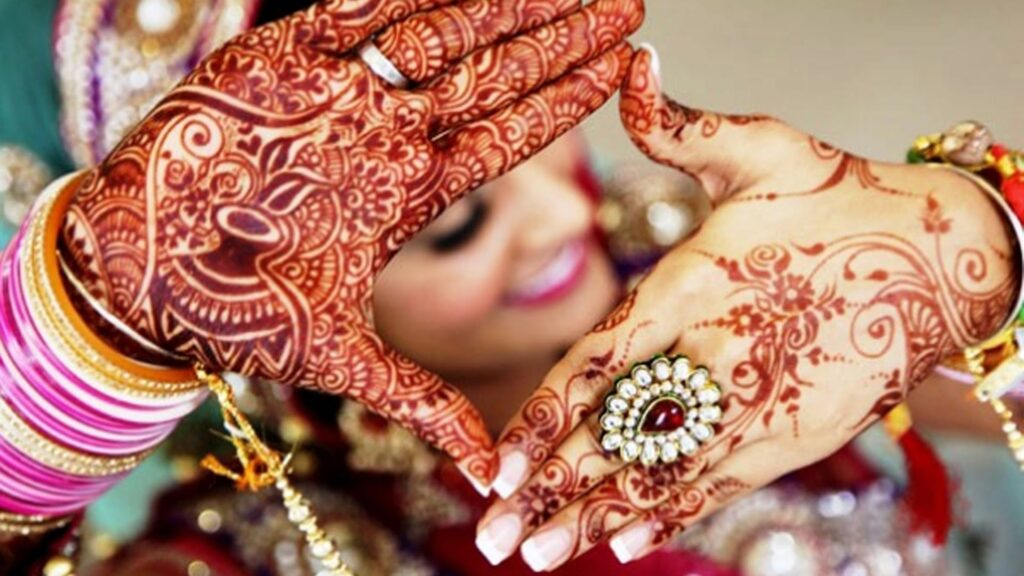 Indian Bride Have Applied Beautiful Henna On Her Hand.