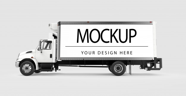 A White Colored Mobile Billboard Truck Moving Through The City That Representing The Mockup For The Advertisement.